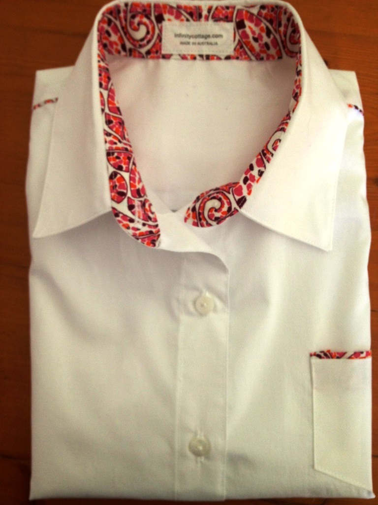 Crisp white cotton shirt with a splash of colour on the collar and cuffs.
